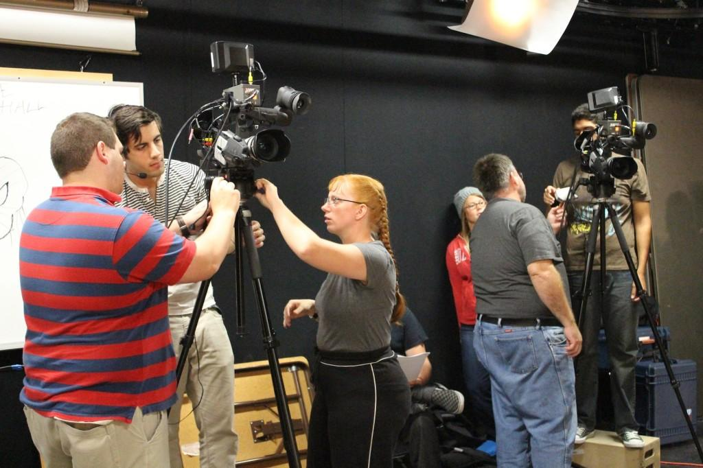 From left: students Jeremy Knight, Shaaheen Karabi and Tracy Gorman set up to film Room at the End of the Hall.