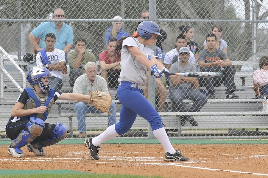 Left fielder Sarah Ragsdale takes an intense swing against McLennon Community College during a home game.