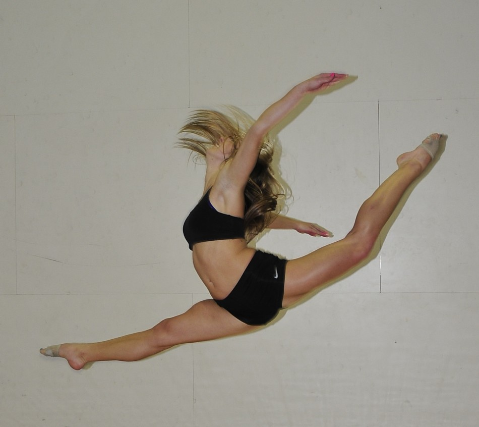 Jordan Fuller performs a split leap during rehearsals for the spring dance show.