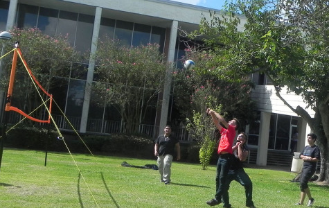 From left: Christian Garcia, Adrian Rodriguez, Benjamin Rosales and John Patrick enjoy a game of volleyball as part of Central campus's Social Media Day.