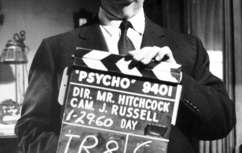 Alfred Hitchcock poses on the set of the 1960 horror classic