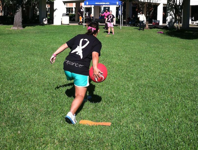 Hannah Hoffman (front) throws to Mary Shelley during last year's cancer awareness event.