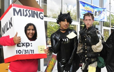 From left: Angie Langdon, Moises Jimenez and James Skeen proudly display their winning costumes at the 2011 Raven Rally.