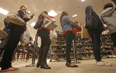 Like many other Americans, bargain-seekers abandon their Thanksgiving tables to battle long lines at Macy's in Costa Mesa, Calif., last year on Black Friday morning.