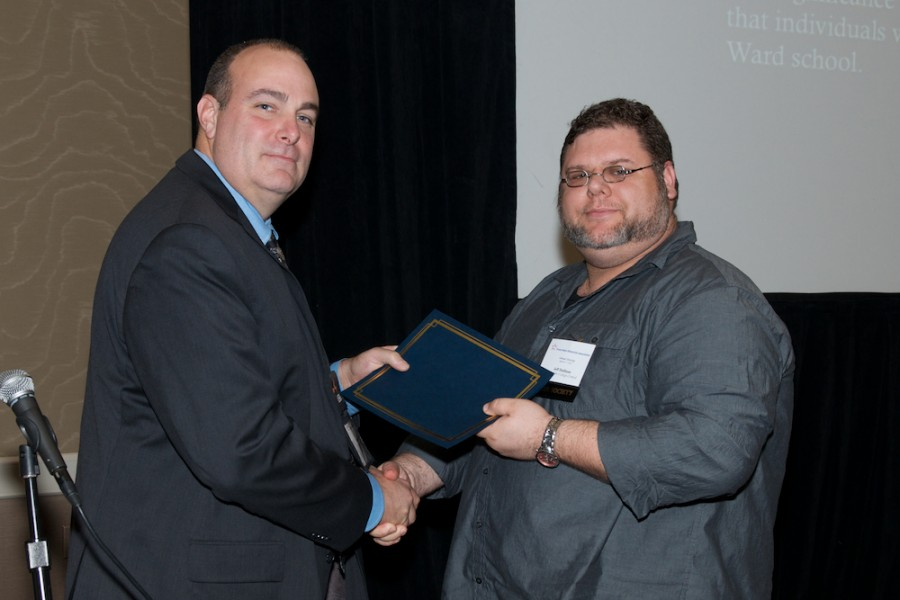 San Jac student Jeffery Hallinan receives his award from TSHA Director of Operations and Education Steve Cure.