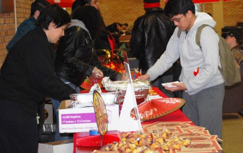Students enjoy egg rolls and fortune cookies while commemorating the Year of the Sheep.