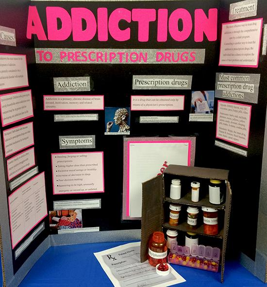 Student Giovanna Randazzo displays her research on prescription drug abuse.