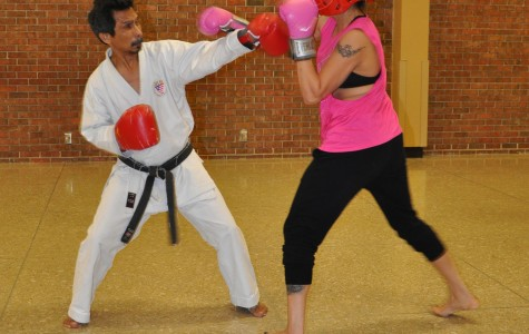 SJC Alum Christina Gil spars with Sensei Deddy Mansyur at the kickboxing demonstration March 4.