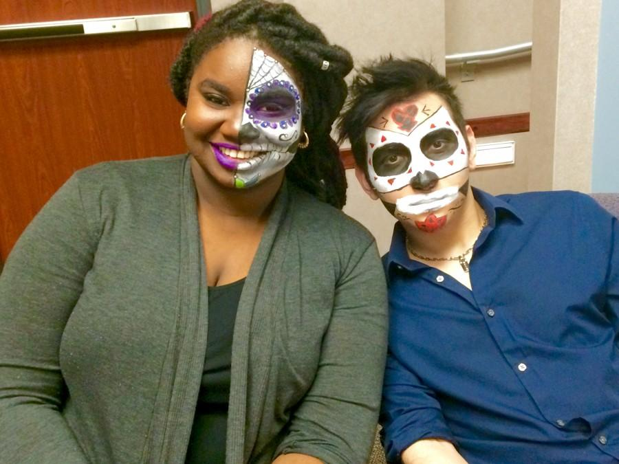 Students Kiani Johnson and Jimmy Durán prepare for a presentation on sugar skulls. Sugar skulls are part of Dia de los Muertos, or Day of the Dead celebrations.