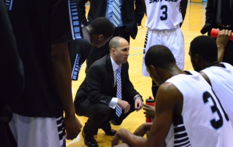Head Coach Scott Gernander rallies his players during a game at Anders Gymnasium. The team currently averages a 3.02 GPA.