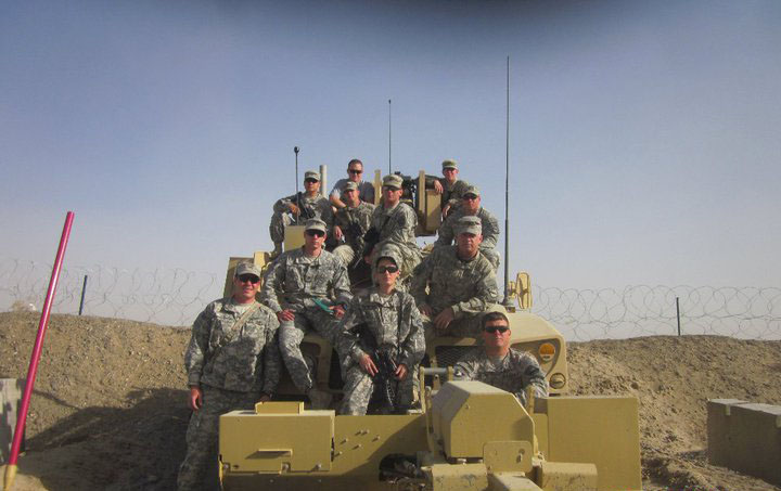 Franklin's United States Army unit 525BFSB poses for a picture on top of a tank in Ft. Bragg, North Carolina.