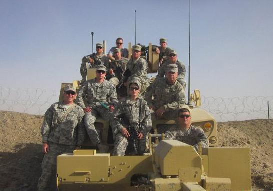San Jac student Oriana Franklin poses for a picture with her unit on top of a tank in Ft. Bragg, North Carolina.