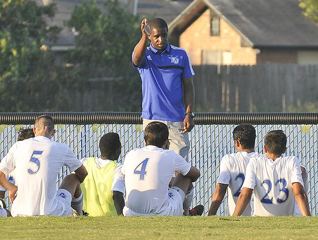 San Jacinto College Men's Soccer Head Coach Ian Spooner gives his players pointers in anticipation of the upcoming season.