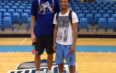 Seven-foot center Konstantin Kulikou (left) from Russia poses with roommate Elroi Butler from Israel. The teammates played together in Spain before coming to San Jac.