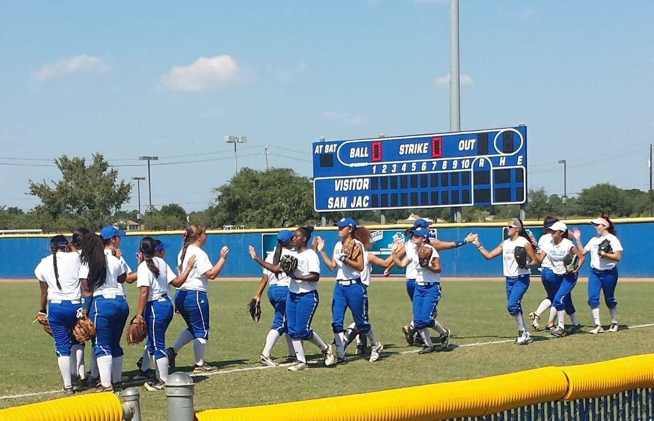 San Jac players high-five each other before taking the field Oct. 11 on the South campus.