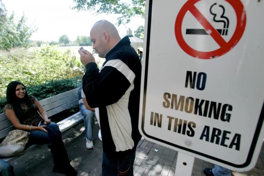 Violations of tobacco bans are commonplace in higher education. Francisco Altamirano (right) and Alexandra Budde, light up next to a no smoking sign in this 2007 photo taken at Bergen Community College in Paramus, New Jersey.
