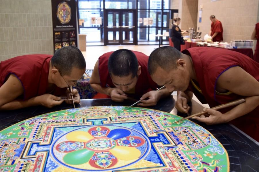 Members of the Drepung Loseling Monastery use colored sand to construct a mandala as part of The Mystical Arts of Tibet showcase hosted on the South campus.