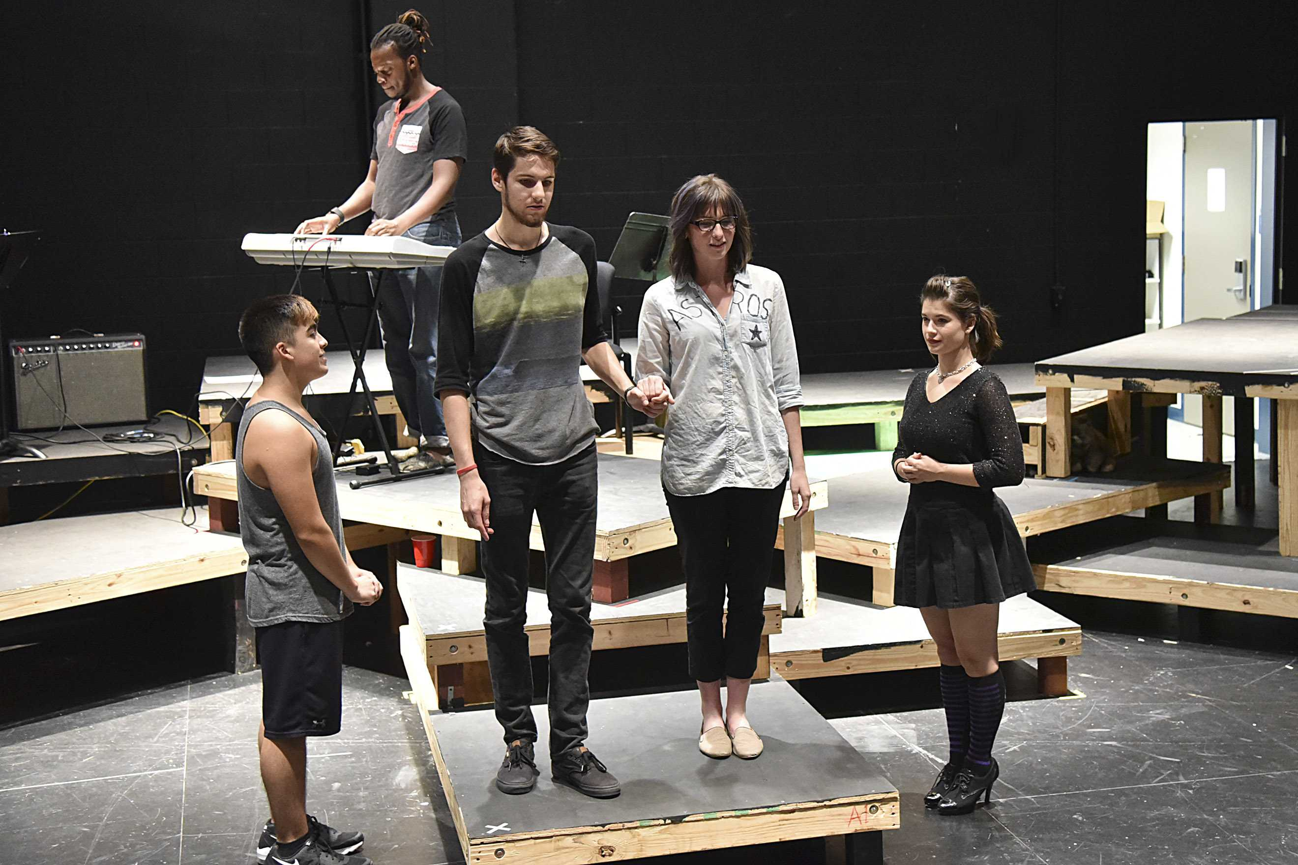 Cast members rehearse a scene from 'United States.'  The show is an original collaboration by the South campus theater program.