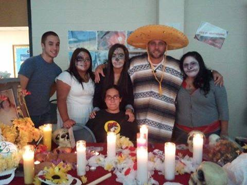 Jose Robles-Rosario (second from right) poses with his students during El Dia de Los Muertos in 2011. Current and former students shared memories of him during a 'Celebration of Life' tribute Nov. 18 on the Central campus.
