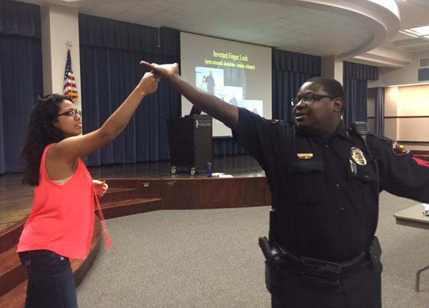 Officer Eric Lister (right) demonstrates how to fend off an attacker during the first SHARP course offered on the South campus as part of a district-wide initiative to prevent sexual violence.