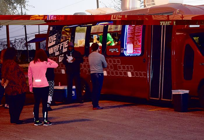 Students venture away from the vending machines and onto the parking lot of the South campus to taste a slew of new dining options available during evening classes. The Waffle Bus is one of several mobile eateries rotating between the San Jac campuses.