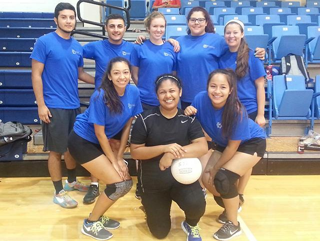 From left: Christian Aritia, Stephanie Barrajas, Rachel Carroll, Jennifer Gonzalez, Alexia Mendez, Jaafar Mouhamad, Natalie Robles, Kennedy Rodriguez, and Belen Tovar pause from playing recreational sports to take a group photo during a 2015 GCIC tournament.