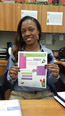 Telishia Long holds up a flyer for Women of Integrity, an organization aimed at empowering women. In support of their mission, the group will host a guest speaker for a presentation March 10 on the Central campus.