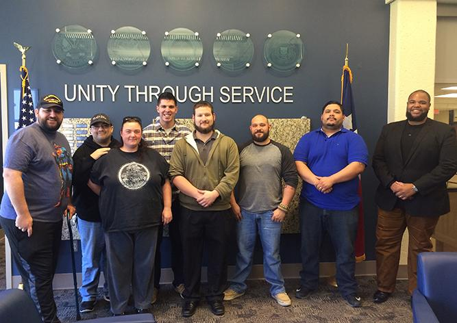 From left: Richard Fly, Steven Whiffen, Alesha Whiffen, Shaston McNaspy, John Smith, Jason Santillan, Pablo Ortiz, and Eugene Bernard take a break from filling out VA paperwork to pose for a picture at the Center of Excellence for Veteran Student Success on the South campus. The Center hosts biweekly SVA meetings where San Jac community members can share their support for transitioning veterans.