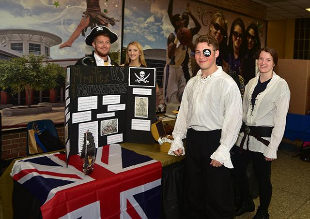 Ahoy matey! Students take a break from manning a pirate-themed booth during last year's literary showcase dedicated to heroes and villains. The 2016 festival takes place April 26 in the Student Center (C14) on the Central campus.