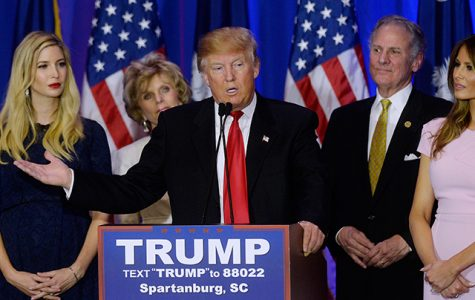 Republican presidential candidate Donald Trump (center), flanked by his daughter Ivanka (left), and his wife Melania Trump, speaks during a primary watch party at the Marriott on Feb. 20 in Spartanburg, S.C.
