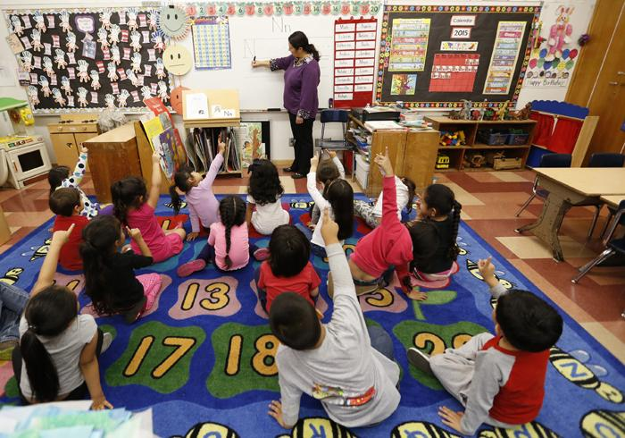 A kindergarten class participates in a learning activity at Dorris Place Elementary School in Los Angeles. The Future Teachers Club on the South Campus offers activities to ready students for the realities of a career in education.