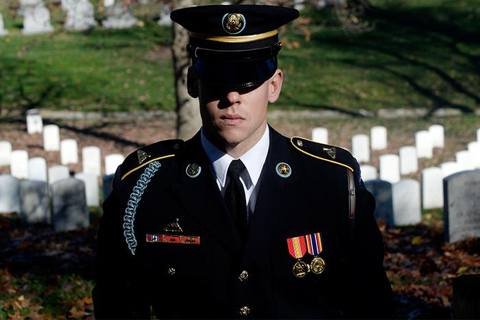 An Honor guard stands still as the motorcade carrying President Barack Obama makes its way into Arlington National Cemetery, Nov. 11, 2015 in Arlington, Va. San Jacinto College will pay tribute to veterans with a series of events scheduled during the week of Nov. 7-11.