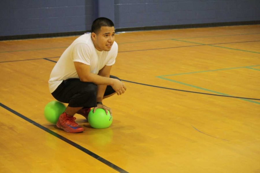 Student worker Jonathan Ortiz enjoys a fun game of Dodgeball in 2013. The activity was canceled the last few semesters due to low participation, but will be open for registration once again on Oct. 24.