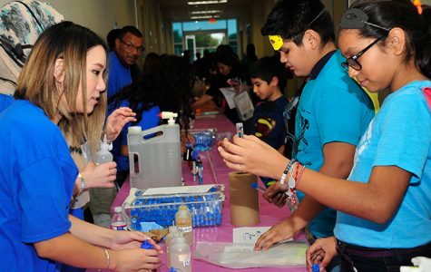 Middle school students participate in hands-on activities at a 2016 STEM showcase.