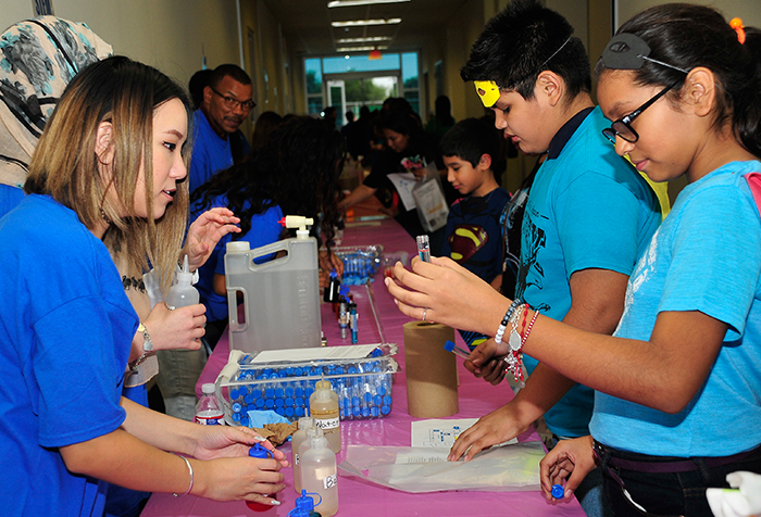 Middle+school+students+participate+in+hands-on+activities+at+a+2016+STEM+showcase.++