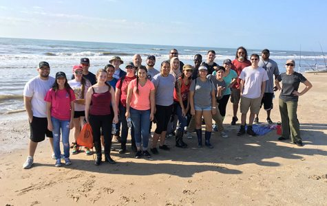 Geology students stop to pose for a photo on McFaddin Beach during a field trip in 2017.