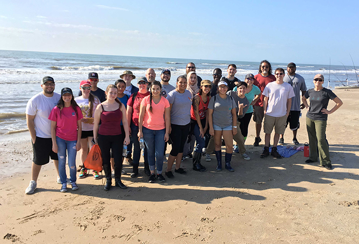 Geology+students+stop+to+pose+for+a+photo+on+McFaddin+Beach+during+a+field+trip+in+2017.