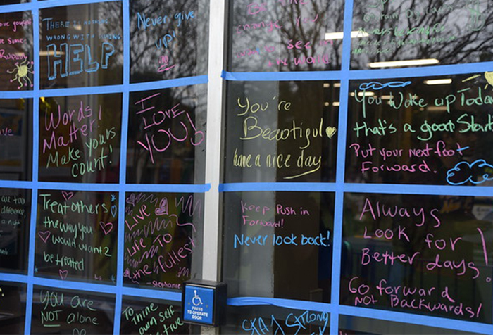 "Celebration attendees on the Central Campus were greeted by a ""Wall of Positive Words"" written on the exterior glass of the Student Center. Arriving guests were asked to contribute messages of inspiration and positivity."