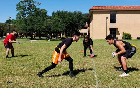 (From left) Willie Escobedo, Bryan Segura, Letty Elizondo, and Jacob Corrigeaux participate in a flag football match as part of the campus's recreation program.