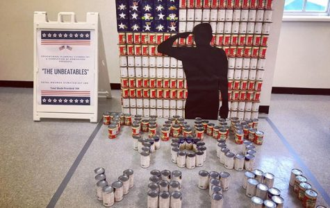 "On the North Campus, The Unbeatables use ravioli cans to spell out ""Thank You Vets!"" as part of their Canstruction submission."
