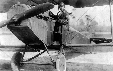 Bessie Coleman, pictured here with her plane in 1922, became the first female civil aviator when she earned her pilot's license in 1921.